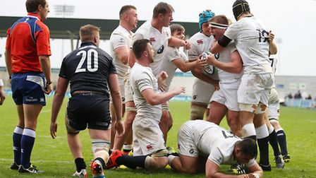 England's Jack Singleton (centre right) celebrates scoring a try with team-mates during the Under 20