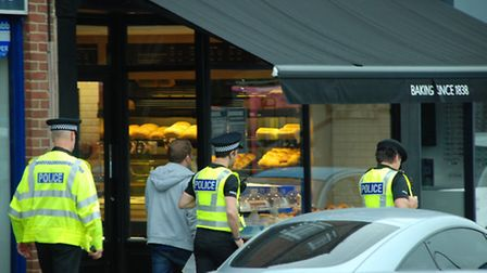 St Albans police officers on their way to execute a warrant at a Londis convenience store