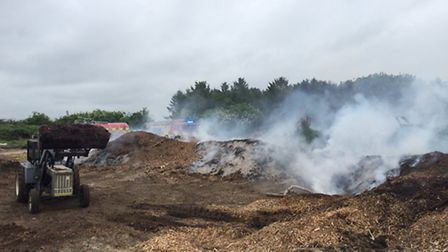 Hundreds of tonnes of wood caught fire in Upwood.