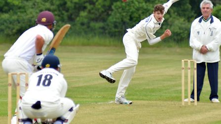 Josh Smith bowls for Needingworth in their victory against Buntingford last Saturday. Picture: HELEN