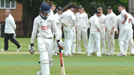 Ramsey players celebrate an Elliot Cafferkey wicket during their win against Wisbech. Picture: HELEN