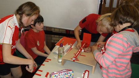 Children from in team Falcon work together to construct the slowest marble run during creative think