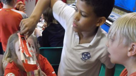 Children organised themselves in the house teams to make the best marble run at Roysia School.