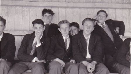 Pupils watching the annual Masters VS Sixth form cricket match in Clarence Park during the summer of