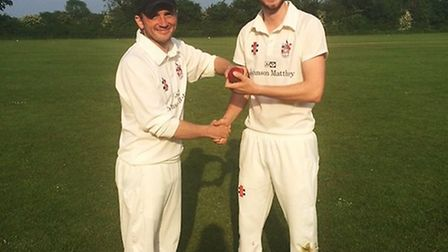 Royston CC captain Paul Harris presents Pete Merrell with the match ball after taking five wickets a