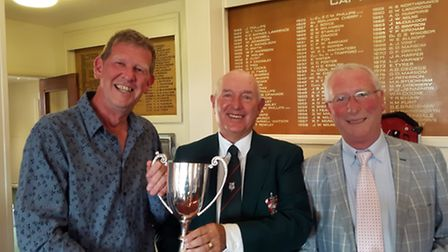 Nigel Thomas (left) receiving the MENCAP winners trophy from club president, Barry Rouse (centre) an