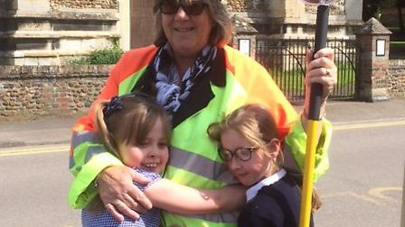 Sue Sharpe with two of the pupils