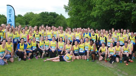 Striders pose for a team photo after a successful first round of the Midweek Road Race League