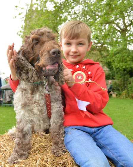 Thomas A Beckett Church Fete, Ramsey, Theo, with his dog Marley, and their winning rosette