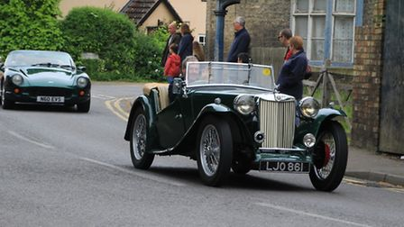 The classic vehicle procession through the village. PICTURE: Clive Porter.
