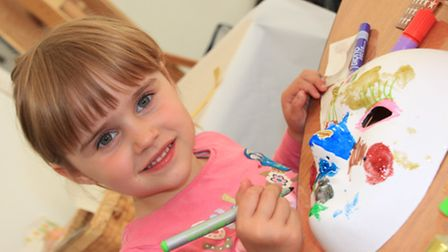 Four-year-old Tahlia Fleming enjoyed the Bash, decorating her own face mask. PICTURE: Clive Porter.