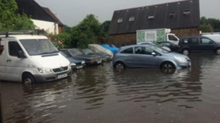 Flooding in the yard of Autotrace Ltd in Park Street Lane - picture from Suzi Clark