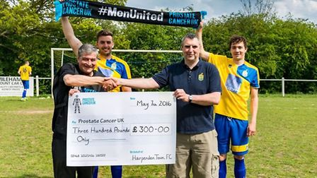 The cheque being presented to Prostate Cancer UK charity volunteer, Steve Gledhill (LEFT). Photo by: