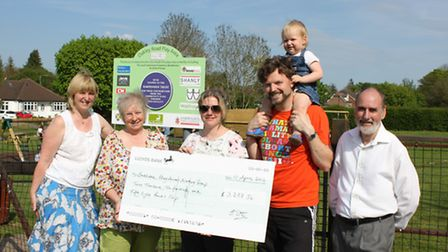 Members of the Southdown Play Areas Working Group receiving the cheque, presented by the Harpenden