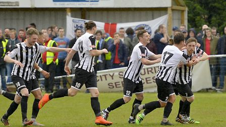 St Ives Town players celebrate the goal, from Ben Seymour-Shove (far right), which won the Southern