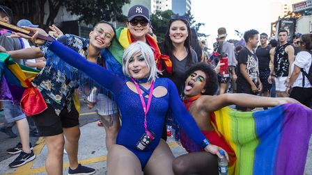 Parade goers attend the Sao Paulo Pride Parade which is celebrating the 50th anniversary of the Ston