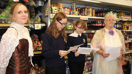 Melbourn Village College students reading from Ulyyses at the Premier convenience store. PICTURE: Cl