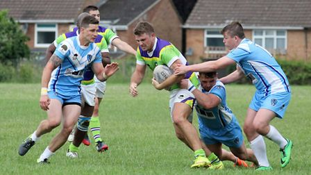 Jake McLoughlin is stopped by the North Herts' defence