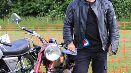 Jamie Burge from nearby Barrington with his father's 1948 250 cc B. S. A. C11, which he has owned fo