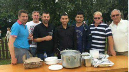 The Yuva team dish up curry to the crowds at Litlington Fayre.