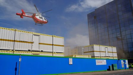 The Air Ambulance takes off from a building site on Grosvenor Road.