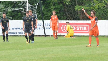 Jack Higgs celebrates his free-kick leveller for St Ives Town. Picture: HELEN DRAKE