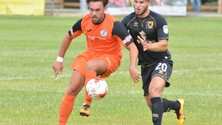 Jack Higgs on the ball during St Ives Town's fine draw against MK Dons. Picture: HELEN DRAKE