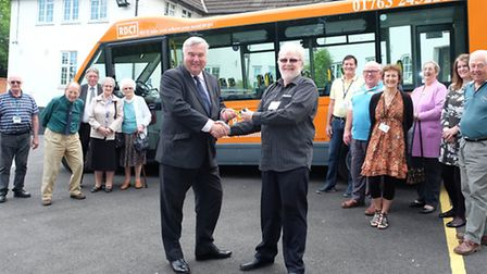 North East Herts MP Sir Oliver Heald hands over the keys to the new mini-bus to Royston & District C