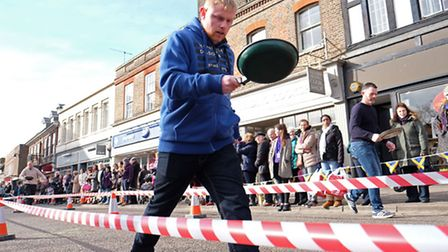 Contestants in the 2016 St Albans flipping pancake walking race