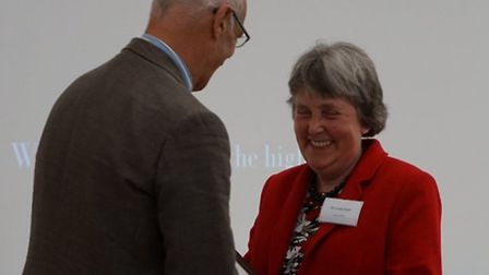 Heartwood Representative, Linda Smith receiving the Bench-Mark Award from Dr Andy Clements, CEO of t