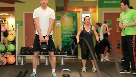 People try out the Synergy 360 Workstation with guidance from a Nuffield personal trainer