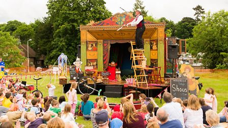 Mr Alexander, the travelling showman entertaining a crowd