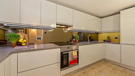 The kitchen includes an integrated washing machine, dishwasher and microwave