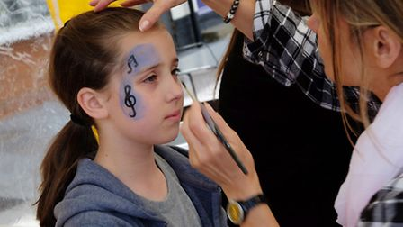 Jess Woods, 10, has her face painted