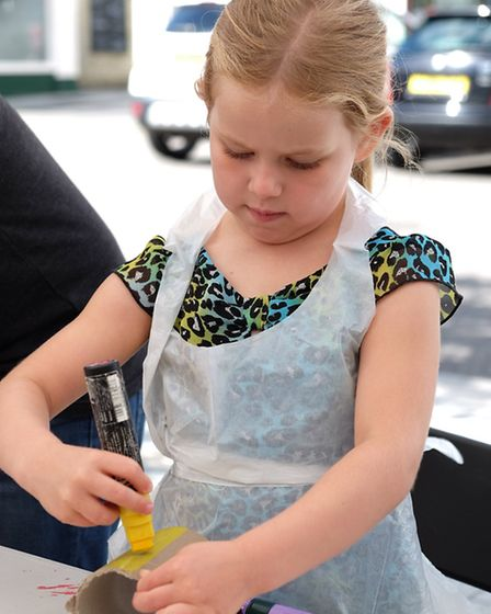Phoebe Rogers, 5 has a go at making a drum