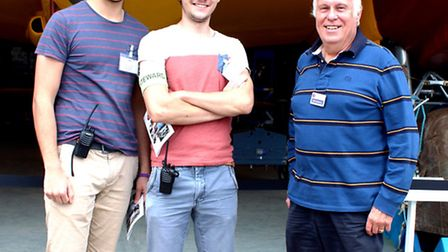 C'est magnifique! French Interns Quentin Andres, left, and Gregory Nicol with museum volunteer co-or