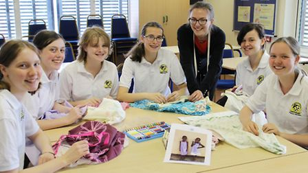 Members of Meridian Sewing Club are having a two day sewing bee.