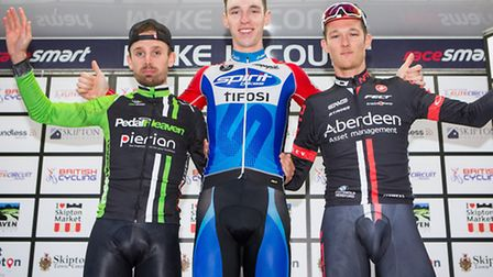 St Neots cyclist Jacob Hennessy (centre) celebrates winning the Skipton Grand Prix. Picture: ALEX WH