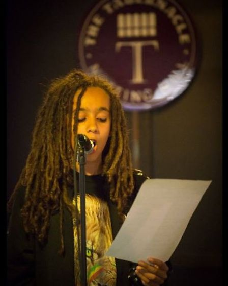 Young St Albans poet Malachi Baptiste performs on stage, after being the victim of racist bullying