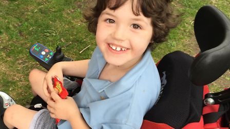 Dominic's powered wheelchair broke six months ago and he now relies on adults to push him around at