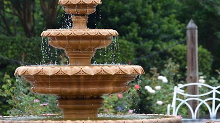 A formal water fountain like this adds a touch of grandeur