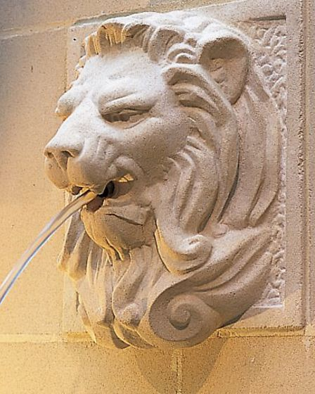 The Lion Wall Fountain provides a touch of stately home chic