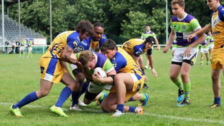 Hemel Stags try to stop Joe Shaw from getting the ball down
