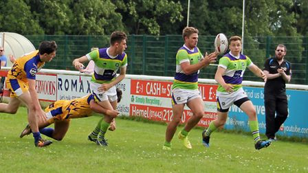 Jake McLoughlin takes a pass from Alex Ricci before racing over the line to score for St Albans
