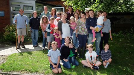 Headteacher Claire Worth (front centre) and a group of volunteers help tidy up Guilden Morden Primar