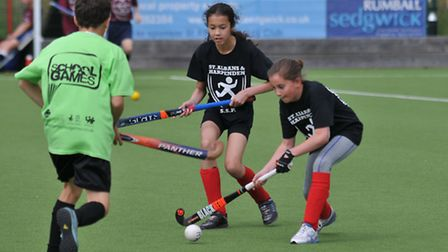 Grove school playing hockey at the Herts School Games