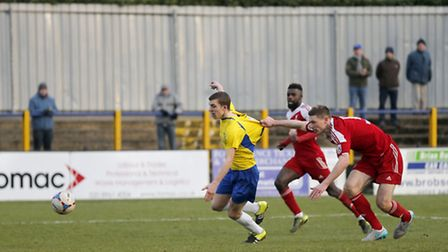 Oran Swales is brought down against Whitehawk. Picture: LEIGH PAGE