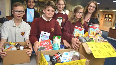 Food donations for Jimmy's Shelter, Cambridge, from St Ivo School Year 8 pupils (l-r) Max, Zainab, S