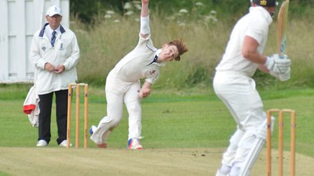 James Dean bowls for Godmanchester during victory against Ramsey yesterday. Picture: HELEN DRAKE