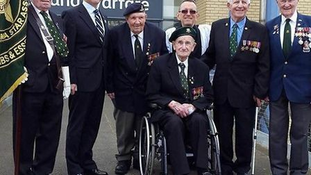 Burma campaign veterans, including Ben (centre) handed over the Standard to the Imperial War Museum,